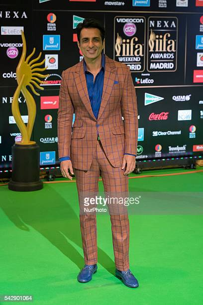 Indian Bollywood actor Sonu Sood poses on the green carpet as she arrives to the 17th edition of IIFA Awards in Madrid on June 24 2016