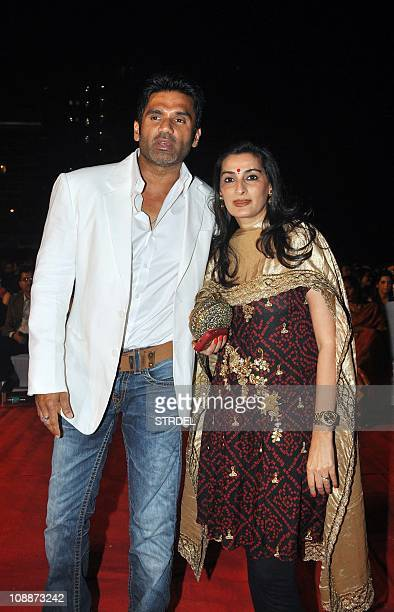 Indian Bollywood actor Suniel Shetty and Mana Shetty look on as they attend the Stardust Awards 2011 ceremony in Mumbai on February 6 2011 AFP...