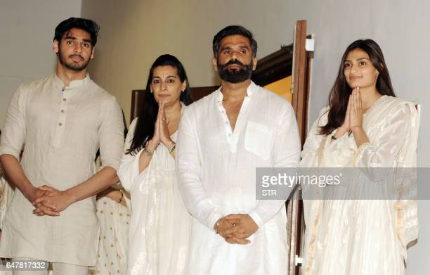 Indian Bollywood actor Suniel Shetty poses with his wife Mana Shetty son Aahan Shetty and daughter Athiya Shetty as they attend a prayer meeting for...
