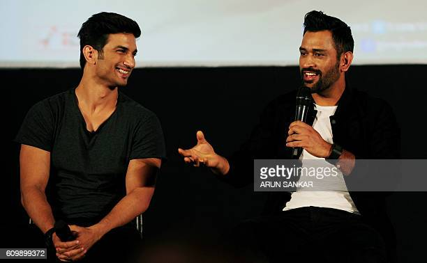 Indian Bollywood actor Sushanth Singh Rajput and Indian cricketer Mahinder Singh Dhoni take part in a promotional event for the forthcoming biopic...