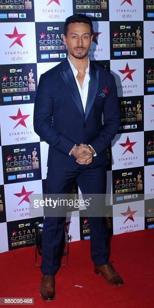 Indian Bollywood actor Tiger Shroff attends the 'Star Screen Awards 2017' ceremony in Mumbai on December 3 2017 / AFP PHOTO /