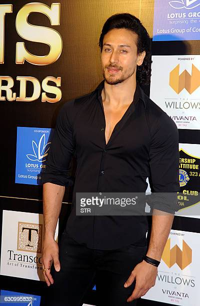 Indian Bollywood actor Tiger Shroff poses as he attends the Lions Gold Awards 2016 in Mumbai late January 4 2017 / AFP / STR