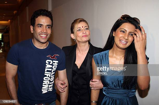 Indian Bollywood actor Tushar Kapoor and actress Geeta Basra pose with French singer Anabelle Varma at a release party for her 'romantic music' hindi...