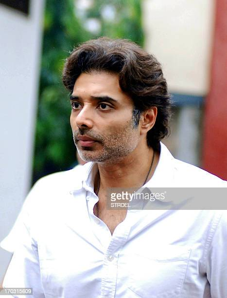 Indian Bollywood actor Uday Chopra arrives to attend the funeral of Ashok Chopra the father of actress Priyanka Chopra in Mumbai on June 10 2013 AFP...