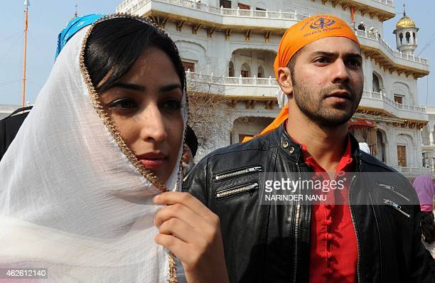 Indian Bollywood actor Varun Dhawan and actress Yami Gautam pose for a photograph at the Golden Temple in Amritsar on February 1 2015 The stars...