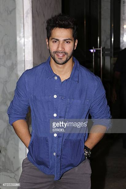 Indian Bollywood actor Varun Dhawan poses as he attends a function in Mumbai late May 4 to celebrate actress Kangana Ranaut winning the National...