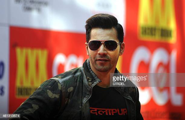 Indian Bollywood actor Varun Dhawan poses for a photograph during the Celebrity Cricket League season five in Mumbai on January 10 2015 AFP PHOTO /...
