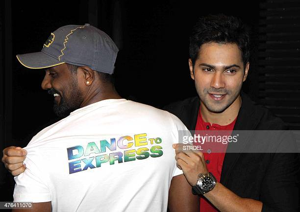 Indian Bollywood actor Varun Dhawan poses with director Remo D'Souza during the launch of a song for the forthcoming Hindi film ABCD 2 in Mumbai late...