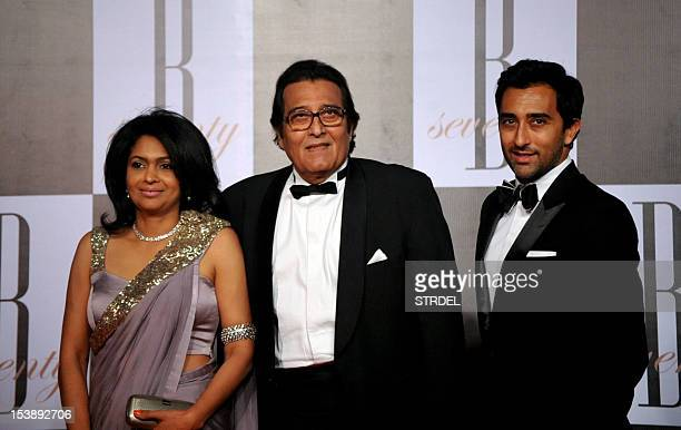 Indian Bollywood actor Vinod Khanna with his wife Kavita and son Rahul Khanna arrive to attend the 70th Birthday celebration of Bollywood Actor...