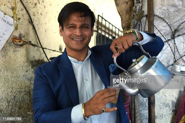 Indian Bollywood actor Vivek Oberoi poses for a picture in a tea stall during the promotion of the biopic Hindi film PM Narendra Modi in Mumbai on...
