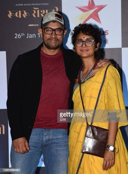 Indian Bollywood actor/producer Aamir Khan with his wife the director Kiran Rao attends the screening of upcoming Star Plus television Hindi Show...