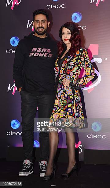 Indian Bollywood actors Abhishek Bachchan and Aishwarya Rai Bachchan pose during the store launch of the fashion label MXS in Mumbai on September 1...