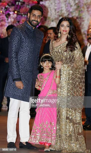 Indian Bollywood actors Abhishek Bachchan and Aishwarya Rai Bachchan and daughter Aaradhya pose for a picture ar the preengagement party of India's...