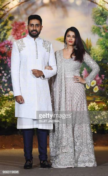 Indian Bollywood actors Abhishek Bachchan with his wife Aishwarya Rai Bachchan pose for a picture during the wedding reception of actress Sonam...