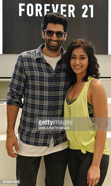 Indian Bollywood actors Aditya Roy Kapoorand Ileana D'Cruz pose for a photograph during a promotional event at a mall in Bangalore on April 29 2016 /...