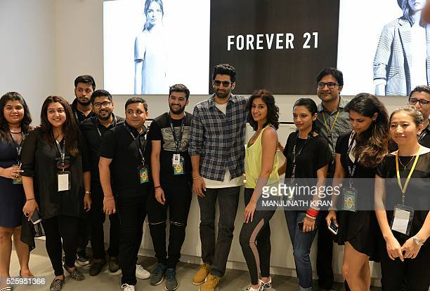 Indian Bollywood actors Aditya Roy Kapoorand Ileana D'Cruzpose for a photograph during a promotional event at a mall in Bangalore on April 29 2016 /...
