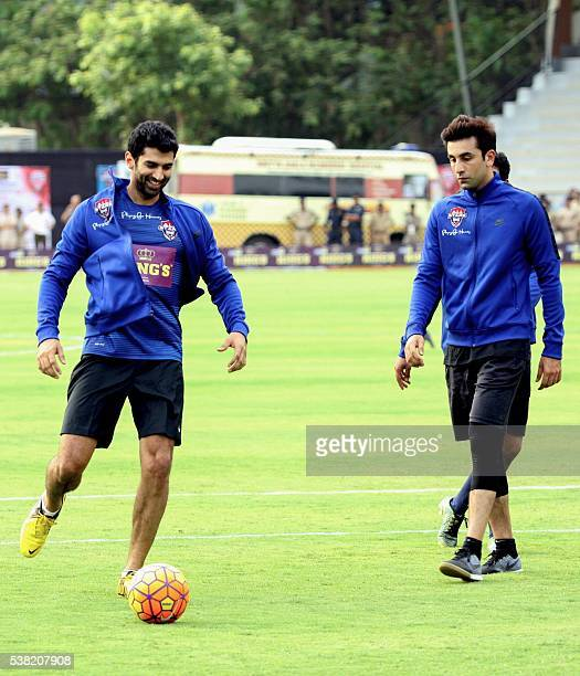 Indian Bollywood actors Aditya Roy Kapur and Ranbir Kapoor take part in the Celebrity Clasico 2016 charity football match organized by the Virat...