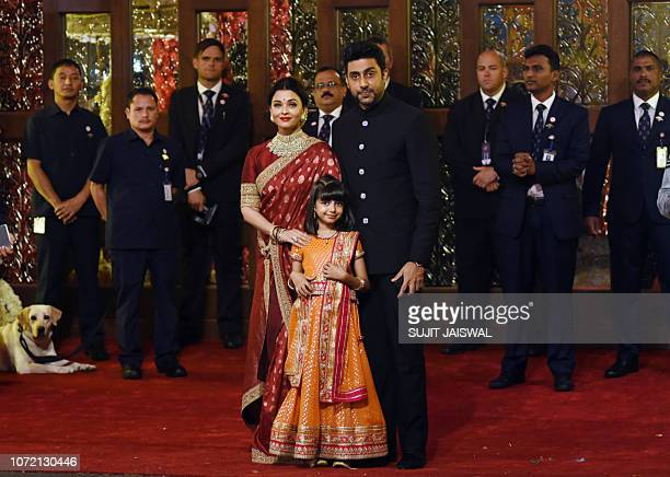 Indian Bollywood actors Aishwarya Rai Bachchan and Abhishek Bachchan with daughter Aradhya pose for a picture as they attend the wedding ceremony of...