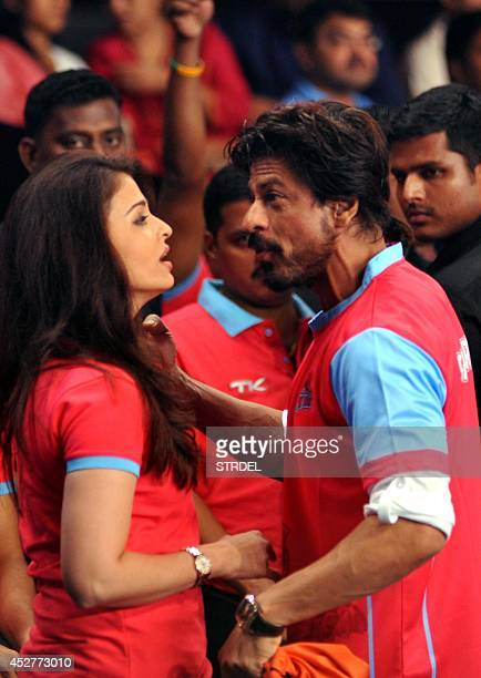 Indian Bollywood actors Aishwarya Rai Bachchan and Shah Rukh Khan talk during a professional kabaddi league match in Mumbai on late July 26 2014 AFP...