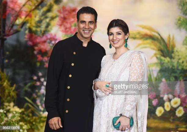 Indian Bollywood actors Akshay Kumar and his wife Twinkle Khanna pose for a picture during the wedding reception of actress Sonam Kapoor and...