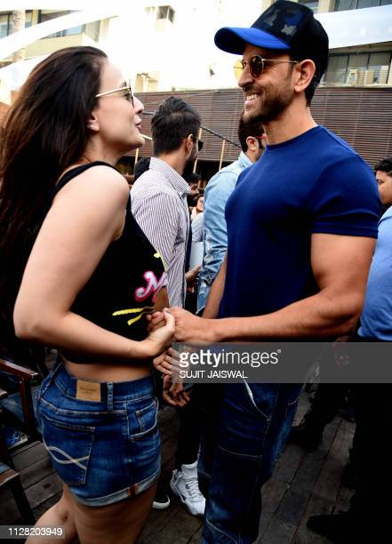 Indian Bollywood actors Ameesha Patel and Hrithik Roshan take part in a blessing event for the start of the upcoming film 'Smile Please' in Mumbai on...
