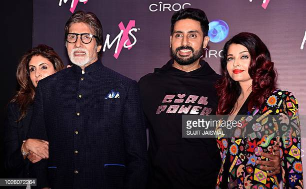 Indian Bollywood actors Amitabh Bachchan Abhishek Bachchan and Aishwarya Rai Bachchan look on during the store launch of the fashion label MXS in...