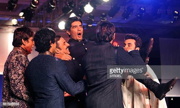 Indian Bollywood actors Amitabh Bachchan Farhan Akhtar Akshay Kumar Siddharth Malhotra and Ranbir Kapoor lift designer Manish Malhotra as they model...
