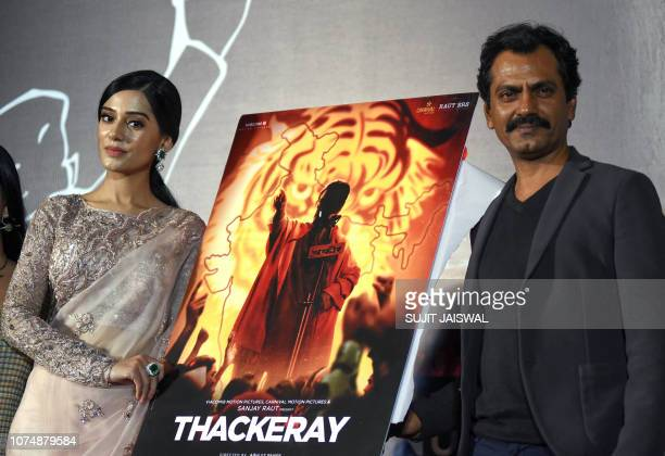 Indian Bollywood actors Amrita Rao and Nawazuddin Siddiqui pose during the trailer launch of the upcoming biographical drama Hindi film 'Thackeray'...