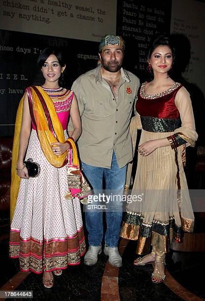 Indian Bollywood actors Amrita Rao Sunny Deol and Urvashi Rautela pose during the first look of the upcoming Hindi film 'Singh Saab the Great' in...
