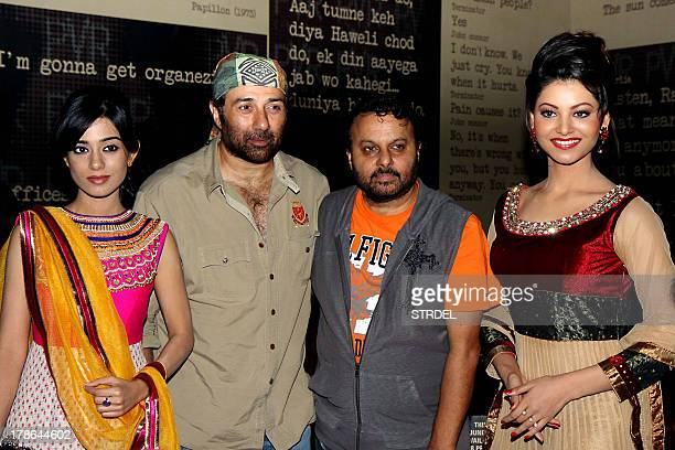 Indian Bollywood actors Amrita Rao Sunny Deol director Anil Sharma and Urvashi Rautela pose during the first look of the upcoming Hindi film Singh...