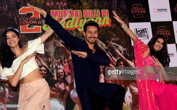 Indian Bollywood actors Ananya Panday Tiger Shroff and Tara Sutaria perform during the song launch of their upcoming romantic comedy drama Hindi film...