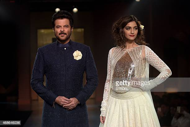 Indian Bollywood actors Anil Kapoor and daughter Sonam Kapoor model creations by designer Manish Malhotra during a charity fashion show in Mumbai on...