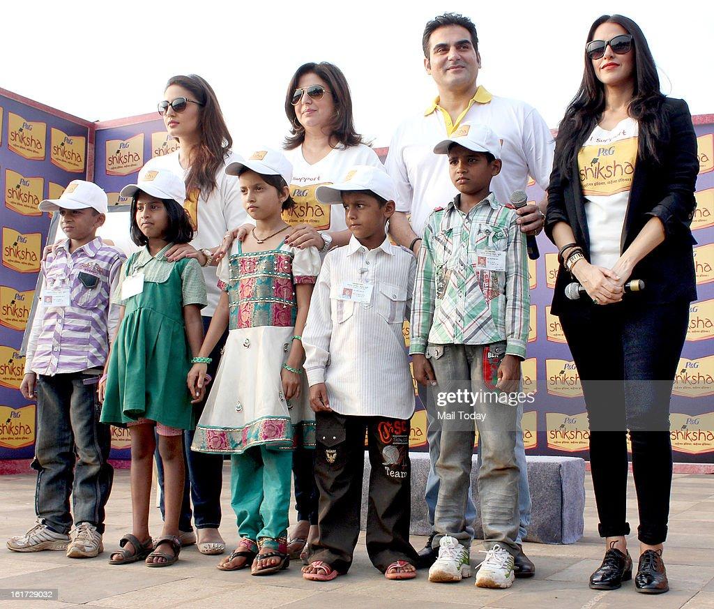 Indian Bollywood actors Arbaaz Khan director and actress Farah Khan Huma Qureshi and Neha Dhupia with kids during a rally by Shiksha School NGO...