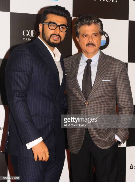 Indian Bollywood actors Arjun Kapoor and Anil Kapoor pose for a photo during the 10th edition of the 'Vogue Women of the Year Awards' event in Mumbai...