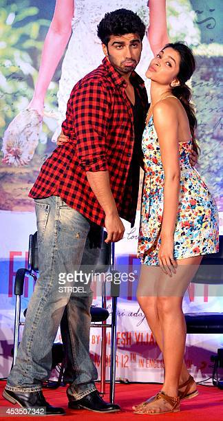 Indian Bollywood actors Arjun Kapoor and Deepika Padukone pose for a photograph during a promotional event for the forthcoming Hindi film 'Finding...
