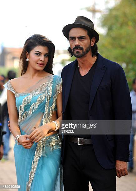 Indian Bollywood actors Arjun Rampal and Jacqueline Fernandez on the sidelines of the set of television show Bigg Boss 8 in Lonavala on January 3...