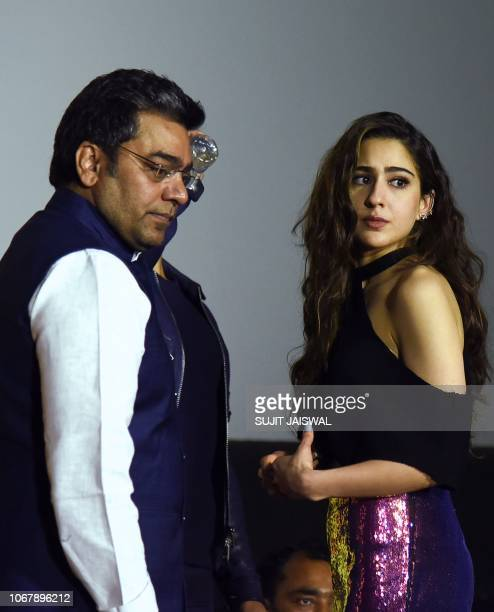 Indian Bollywood actors Ashutosh Rana and Sara Ali Khan look on during the trailer launch of their upcoming Hindi film 'SIMMBA' in Mumbai on December...