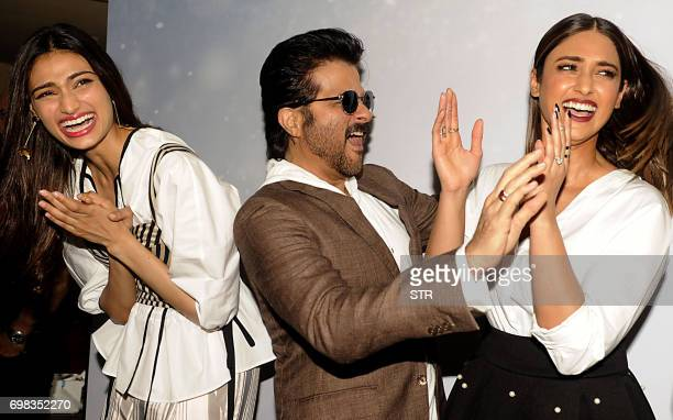 Indian Bollywood actors Athiya Shetty Anil Kapoor and Ileana DCruz react during a promotional event for the forthcoming Hindi film 'Mubarakan'...