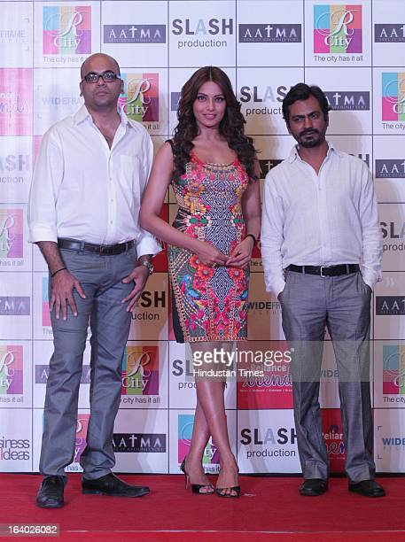 Indian Bollywood actors Bipasha Basu and Nawazuddin Siddiqui with filmmaker Suparn Verma during the promotion of their upcoming film Aatma on March...
