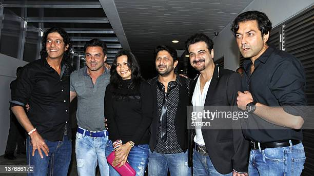 Indian Bollywood actors Chunky Pandey Sohail Khan Maria Arshad Warsi's wife Arshad Warsi Sanjay Kapoor and Bobby Deol pose as they arrive to attend...