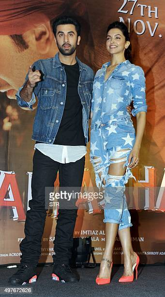 Indian Bollywood actors Deepika Padukone and Ranbir Kapoor pose during the promotional press conference for the upcoming Hindi film 'Tamasha'...