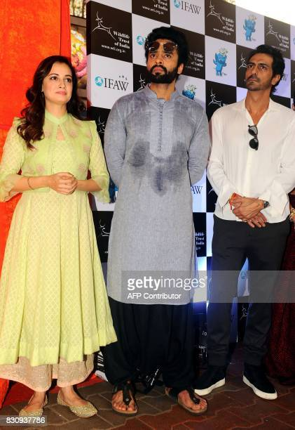 Indian Bollywood actors Dia Mirza Jackky Bhagnani and Arjun Rampal pose for a photograph during the launch of Gaj Yatra a campaign to save India's...