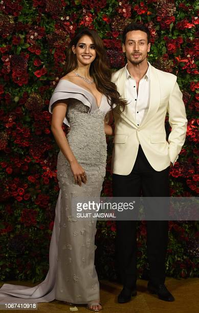 Indian Bollywood actors Disha Patani and Tiger Shroff pose for a picture during the wedding reception party of actors Ranveer Singh and Deepika...