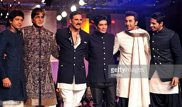 Indian Bollywood actors Farhan Akhtar Amitabh Bachchan Akshay Kumar Ranbir Kapoor and Siddharth Malhotra model creations by designer Manish Malhotra...