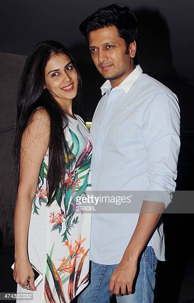 Indian Bollywood actors Genelia D'Souza and her husband Riteish Deshmukh pose for a photograph during a promotional event for the forthcoming Hindi...