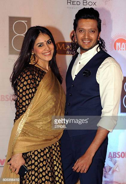 Indian Bollywood actors Genelia D'Souza and Riteish Deshmukh pose for a photograph during the Vikram Phadnis fashion show in Mumbai on late January...