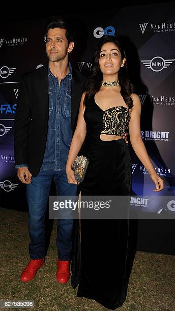 Indian Bollywood actors Hrithik Roshan and Yami Gautam attend the GQ Fashion Nights 2016 menswear fashion show in Mumbai on December 3 2016 / AFP /