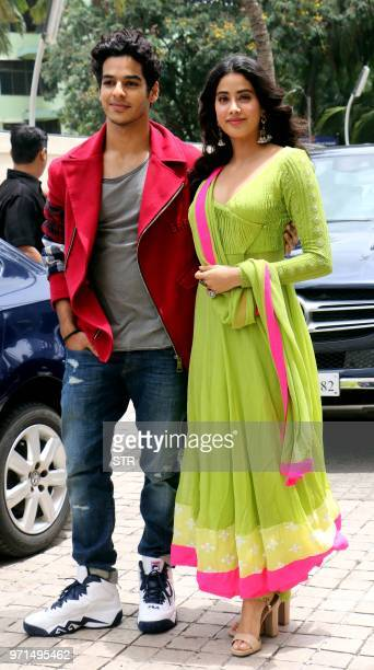 Indian Bollywood actors Ishaan Khatter and Janhvi Kapoor look on during the trailer launch of the upcoming romantic drama Hindi film 'Dhadak' in...