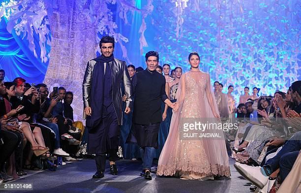 Indian Bollywood actors Jacqueline Fernandez and Arjun Kapoor showcase creations by designer Manish Malhotra at a Lakme Fashion Week Summer 2016 show...