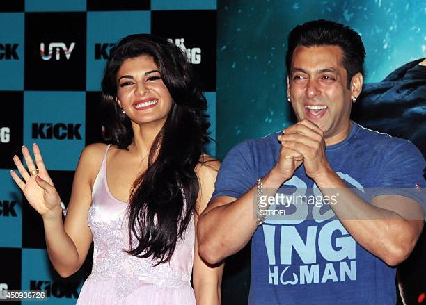 Indian Bollywood actors Jacqueline Fernandez and Salman Khan pose for a photograph during a promotional event for the forthcoming Hindi film 'Kick'...